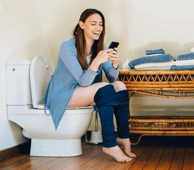 woman using smartphone in toilet